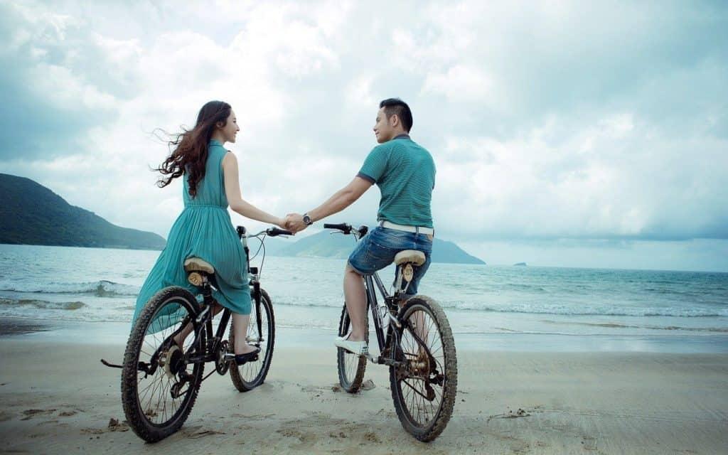 couple, beach, bicycles